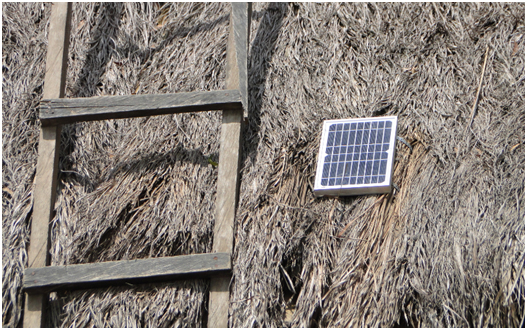 Installed solar panel on a thatched roof